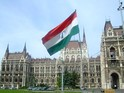 1956 Revolution Flag flying in front of the Hungarian Parliament Building