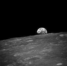 The Moon from lunar orbit, with planet Earth rising over the horizon, taken on the Apollo 8 mission by astronaut William Anders on December 24, 1968.