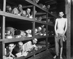 Jewish slave laborers at the Buchenwald concentration camp near Weimar photographed after their liberation by the Allies on 16 April 1945. Elie Wiesel is seen second row from bottom, seventh figure from the left.