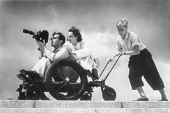 Leni Riefenstahl (behind cameraman) at the 1936 Summer Olympics