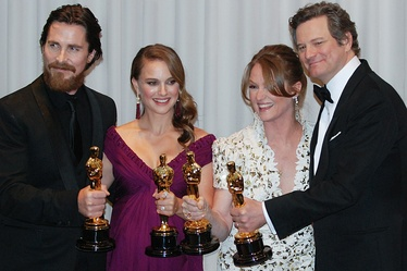 Academy Award winners (from left to right):- Christian Bale, best supporting actor—The Fighter- Natalie Portman, best actress—Black Swan- Melissa Leo, best supporting actress—The Fighter- Colin Firth, best actor—The King's Speechwith trophies known as Oscars (2011)
