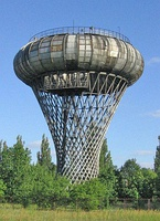 Hyperboloid water tower with toroidal tank, Ciechanów, Poland, 1972.