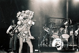 "Rutherford, Gabriel, and Collins in 1974 during The Lamb... tour. Gabriel is wearing the ""Slipperman"" costume."