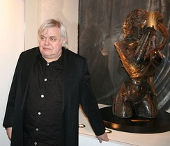 H. R. Giger with a Sil sculpture