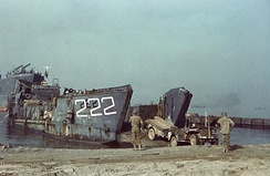 U.S. Navy tank landing craft offloads a U.S. Army jeep at Salerno.