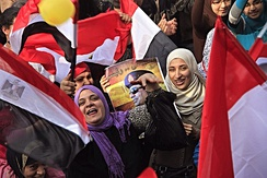 Participants holding flags and pictures of Abdel Fattah el-Sisi