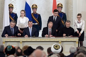 Vladimir Putin (third, left), Sergey Aksyonov (first, left), Vladimir Konstantinov (second, left) and Aleksei Chalyi (right) sign the Treaty on Accession of the Republic of Crimea to Russia