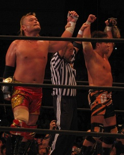 Tenzan (left) and Satoshi Kojima as the NWA World Tag Team Champions in June 2014.