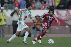 Players from Raja (left) and Wydad (right) during a Casablanca derby match in 2008.