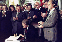 Carter signing the Airline Deregulation Act