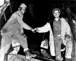 Soldiers of the U.S. Army Corps of Engineers meeting in the middle after completing construction of the Alaska Highway