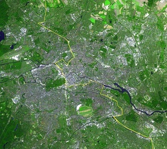 Satellite image of Berlin, with the Wall's location marked in yellow