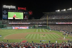 President George W. Bush throws the ceremonial first pitch before a sold out crowd at the Washington Nationals' season opener on March 30, 2008