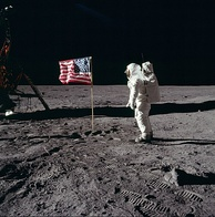 Astronaut Buzz Aldrin salutes the United States flag on the surface of the moon during the Apollo 11 mission (1969)