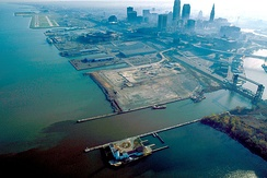 1992 aerial view of the Cleveland harbor, with the mouth of the Cuyahoga River in the foreground (view towards the east)