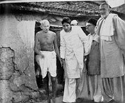 Gandhi touring Bela, Bihar, a village struck by religious rioting in March 1947. On the right is Khan Abdul Gaffar Khan.