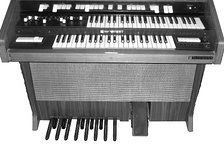 This Hammond spinet organ shows the relatively short pedals and 13-note range used on the pedalboards of spinet organs