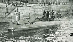 Submarine surfaced in a Japanese harbour
