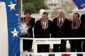 Linda Lingle smashes a bottle of champagne against the sail of the USS Hawaii (SSN-776) during the ship's christening ceremony.