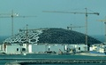 Louvre Abu Dhabi under construction in 2015, its dome built up of layers of stars made of octagons, triangles, and squares