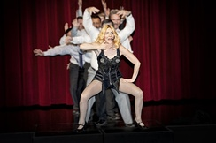 "A Madonna impersonator dancing to the singer's ""Vogue""."
