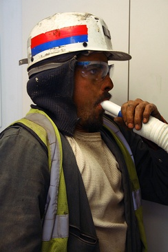 Miners can be regularly monitored for reduced lung function due to coal dust exposure using spirometry.