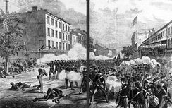 The Orange riot of 1871 as depicted in Frank Leslie's Illustrated Newspaper. The view is at 25th Street in Manhattan looking south down Eighth Avenue.