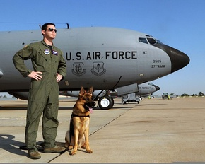 U.S. Air Force Capt. Greg Auerbach, a 54th Air Refueling Squadron KC-135 Stratotanker aircraft instructor pilot, stands with his German shepherd, Ronnie, on the flight line at Altus Air Force Base, Okla 110615-F-CM321-999.jpg