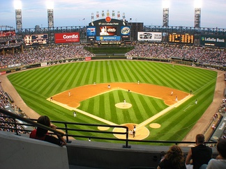 "Guaranteed Rate Field with its iconic ""exploding scoreboard"" in center field"