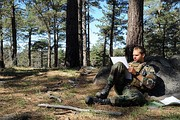 Third Phase A student plots coordinates on his map during an individual land navigation exercise in Mount Laguna.