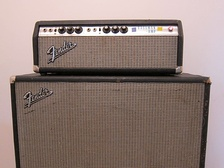 "A Fender Bassman amp head with a 15"" speaker cabinet."