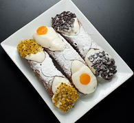 Cannolis with Pistachio Grain, Candied  and Chocolate Drops