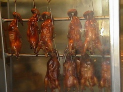 A display of Cantonese roast duck for sale in a delicatessen in Chinatown, Los Angeles