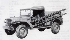 WC-59, 3/4-ton K-50 telephone truck with ladder on side.