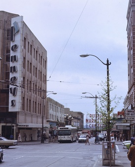 Former Downtown Seattle store in 1982, with signage from the period when the chain was branded as Penneys and used a more stylized font in its logo. Pike Place Market is in the background.