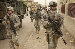 Soldiers from the 3rd Stryker Brigade Combat Team, 2nd Infantry Division patrolling Dora in Iraq during 2007