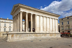 The Maison Carrée in Nîmes, one of the best-preserved Roman temples.  It is a mid-sized Augustan provincial temple of the Imperial cult.