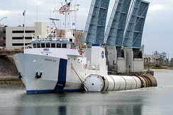 Solid rocket booster of the STS-131 mission being recovered and transported to Cape Canaveral by the MV Freedom Star.