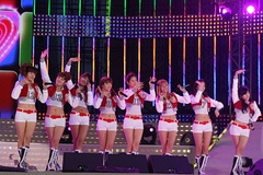 "In their early years, the group was known for performing synchronized dance moves in uniforms (left: the performance of 2010's ""Oh!""). With their later release, the group aimed for a more mature image, choosing their own performing outfits (right: the performance of 2011's ""The Boys"")."
