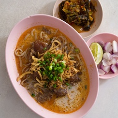 Khao soi at a Chin Haw restaurant in Chiang Mai