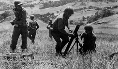 American troops fire 81mm mortars in support of the Seventh Army's drive on Palermo.