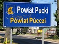 Bilingual sign in Polish and Kashubian in Pogórze, Puck County, Poland, on road from Gdynia to Rewa