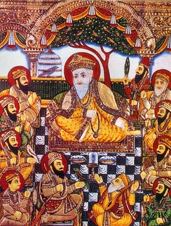 Guru Nanak in the center, amongst other Sikh figures