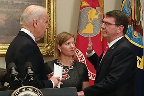Vice President Joe Biden swears in Ash Carter as the 25th defense secretary as Carter's wife, Stephanie, looks on during a private ceremony at the White House
