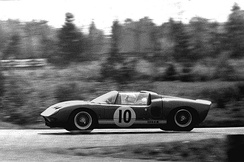 Richard Attwood driving the open, spyder version of the Ford GT, at the Nürburgring in 1965.