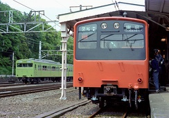 The prototype unit of JNR 201 series on public display at Harajuku Station in Tokyo, 13 May 1979. Next to it, a Yamanote Line's  103 series train can be seen passing through