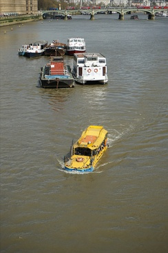 Amphibious tour bus - a converted DUKW - on Thames river in London near Lambeth Bridge.