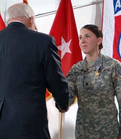 Brown receives the Silver Star from Vice President Dick Cheney in March 2008.
