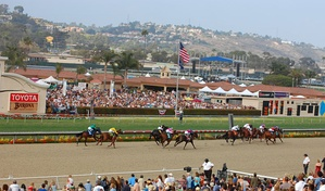 Horses crossing the finish line at the Del Mar Racetrack