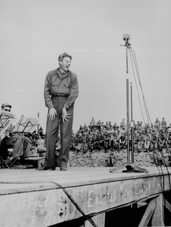 Danny Kaye on USO tour at Sasebo, Japan, October 25, 1945. Kaye and his friend, Dodgers manager Leo Durocher, made the trip.[25]